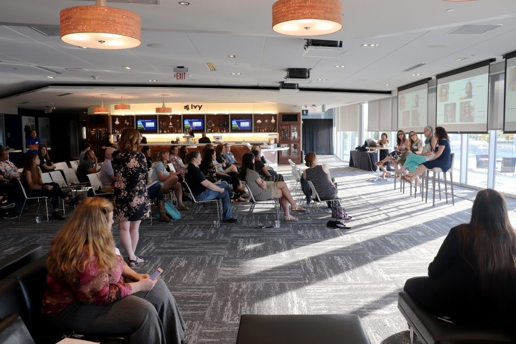 People gather for Kansas City Women in Technology's May 2019 Tech Talk on remote work at Children's Mercy Park.